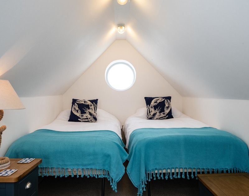 The bedroom with four single bedrooms at Balderstone self catering holiday home in Polzeath, North Cornwall.