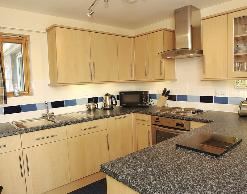 The kitchen in Polzeath Court 4, a self catering holiday apartment to rent in New Polzeath on the North Coast of Cornwall.