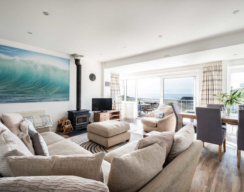 The stylish open plan sitting room area of Balderstone, a self-catering holiday house in Polzeath, Cornwall.