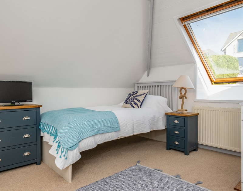 The light filled bedroom with four single beds at Balderstone self catering holiday home in Rock, North Cornwall.