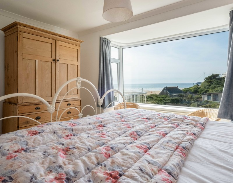 The master bedroom with amazing sea views at Balderstone self catering holiday home in Rock, North Cornwall.