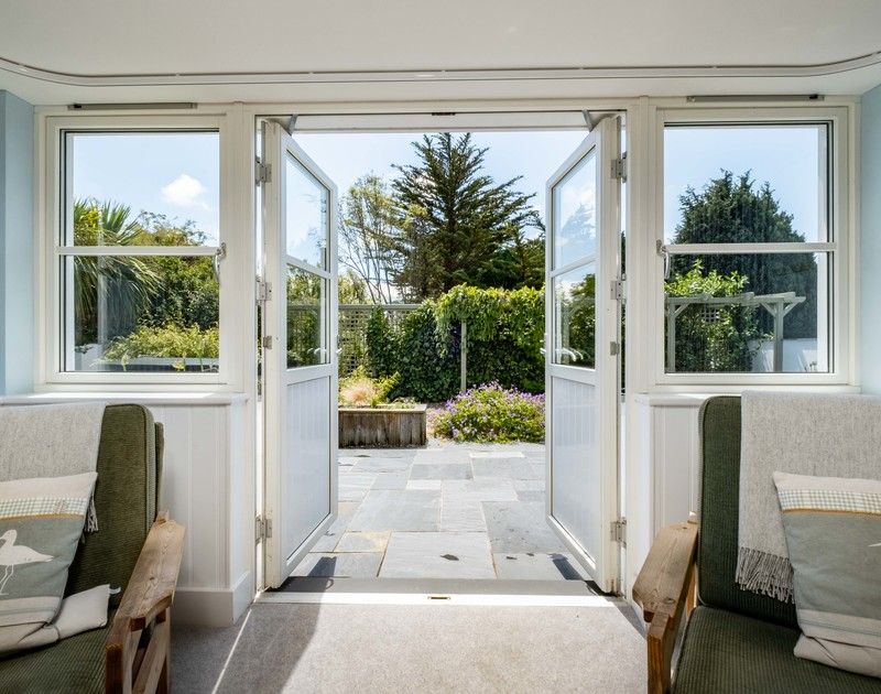 Patio doors to the garden and hot tub at Cherrytrees self catering holiday home in North Cornwall.