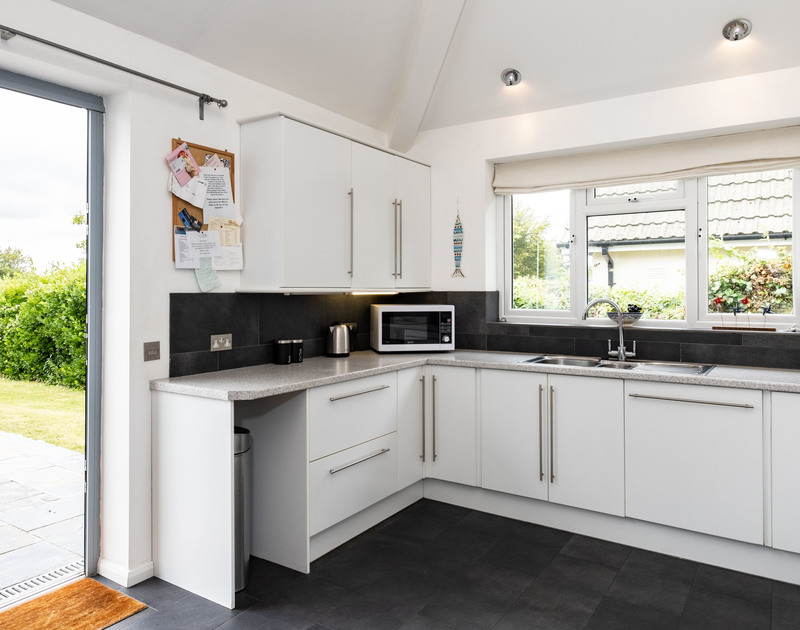 The well equipped kitchen at Lerryn self catering holiday home in North Cornwall.