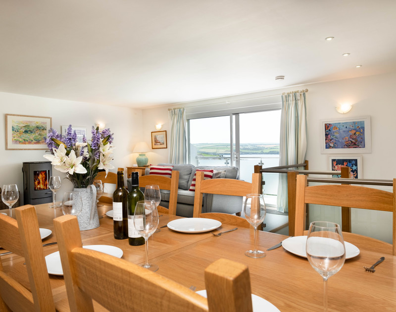The open plan dining/living room in Drifters, a luxury holiday house to rent in Rock, North Cornwall.