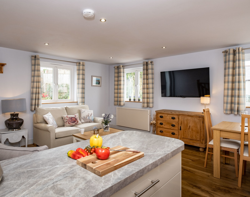 The open plan kitchen, living and dining room at The Hideaway self catering holiday home in Port Isaac.