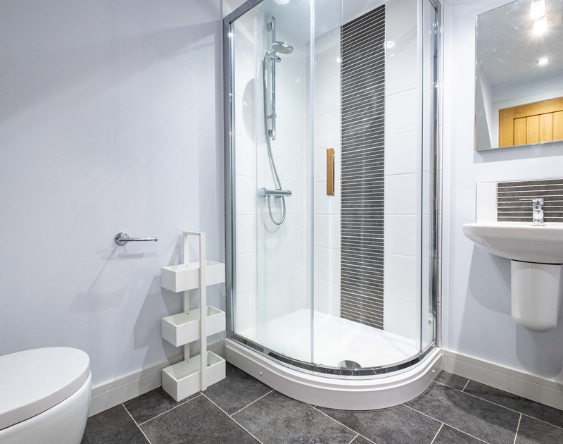 The modern bathroom with shower at The Hideaway in Port Isaac in North Cornwall.