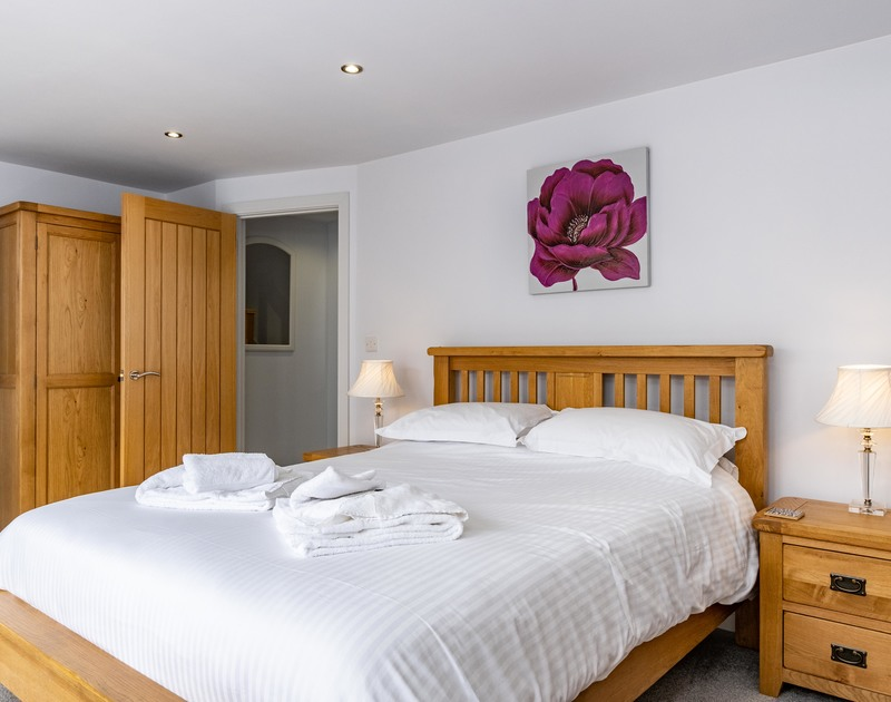 The master king bedroom at The Hideaway self catering holiday home in Port Isaac, North Cornwall.