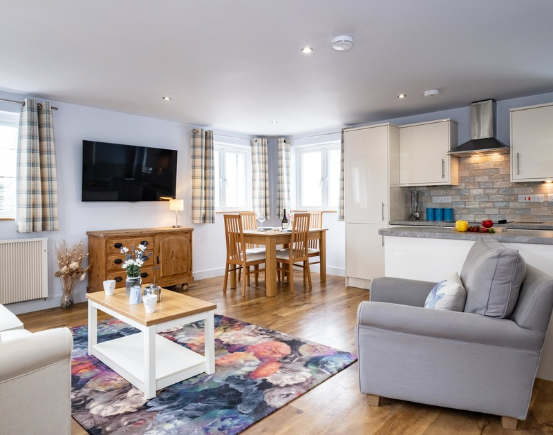 The spacious open plan kitchen, living and dining room at The Hideaway in Port Isaac in North Cornwall.