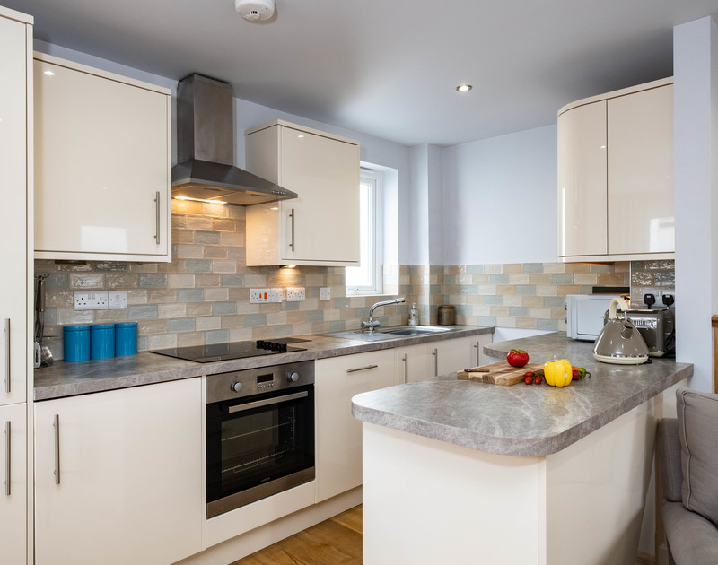 The well equipped kitchen at The Hideaway self catering holiday cottage in Port Isaac in North Cornwall.