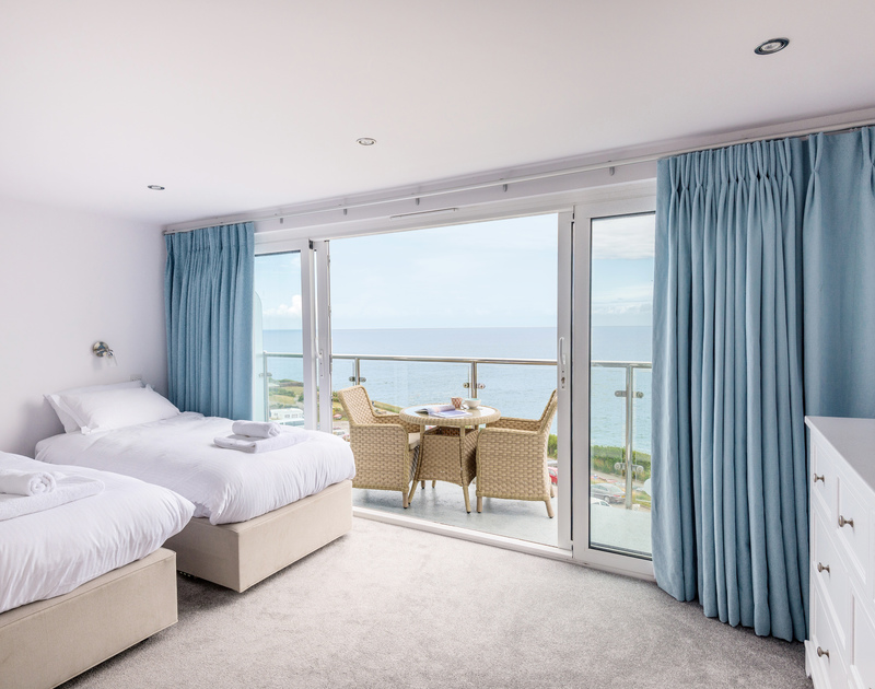 The twin bedroom with ensuite bathroom and private balcony with sea views at The Lawns self catering holiday home in Port Isaac in North Cornwall.