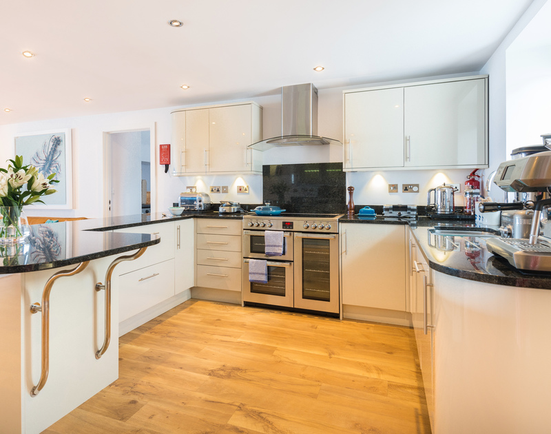 The well equipped kitchen at The Lawns self catering holiday home in Port Isaac in North Cornwall.