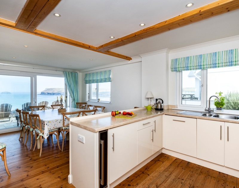 The well equipped kitchen with sea views at Treleven holiday home in Polzeath, North Cornwall.
