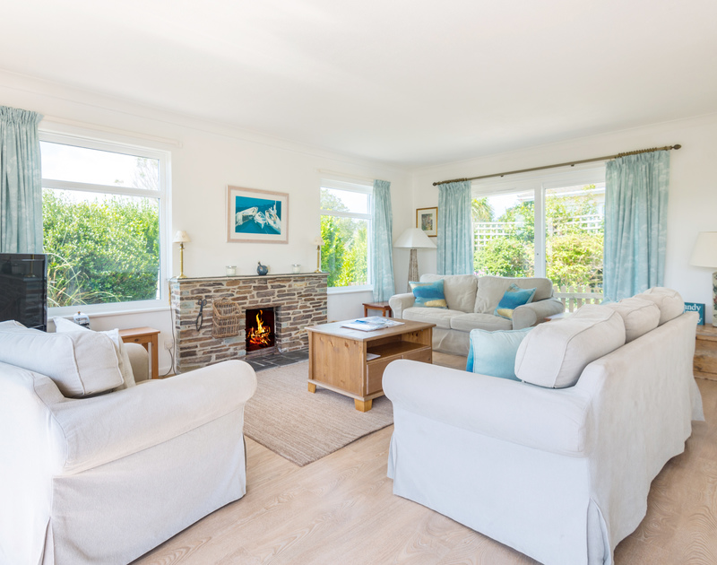 The spacious living room with fire place at Tremay self catering holiday home in Rock, North Cornwall.