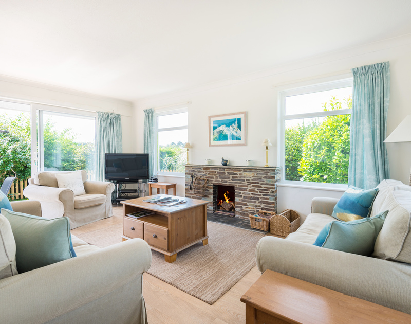 The comfortable living room with fire place at Tremay self catering holiday home in Rock, North Cornwall.