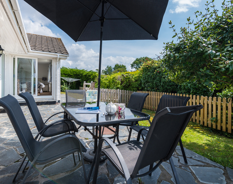 The sunny patio at Tremay self catering holiday home in Rock, North Cornwall.