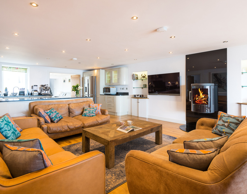 The open plan living, kitchen and dining area at The Lawns self catering holiday home in Port Isaac in North Cornwall.