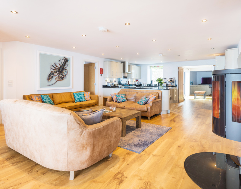 The spacious open plan living, kitchen and dining area at The Lawns self catering holiday home in Port Isaac in North Cornwall.