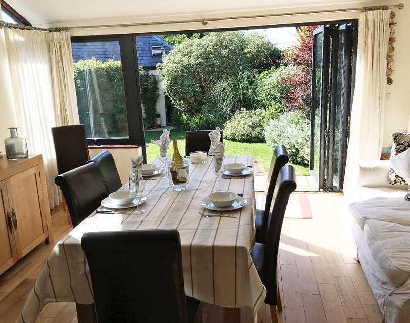 The smart, spacious dining room of Gulls Cottage, a self-catering holiday house in Rock, Cornwall