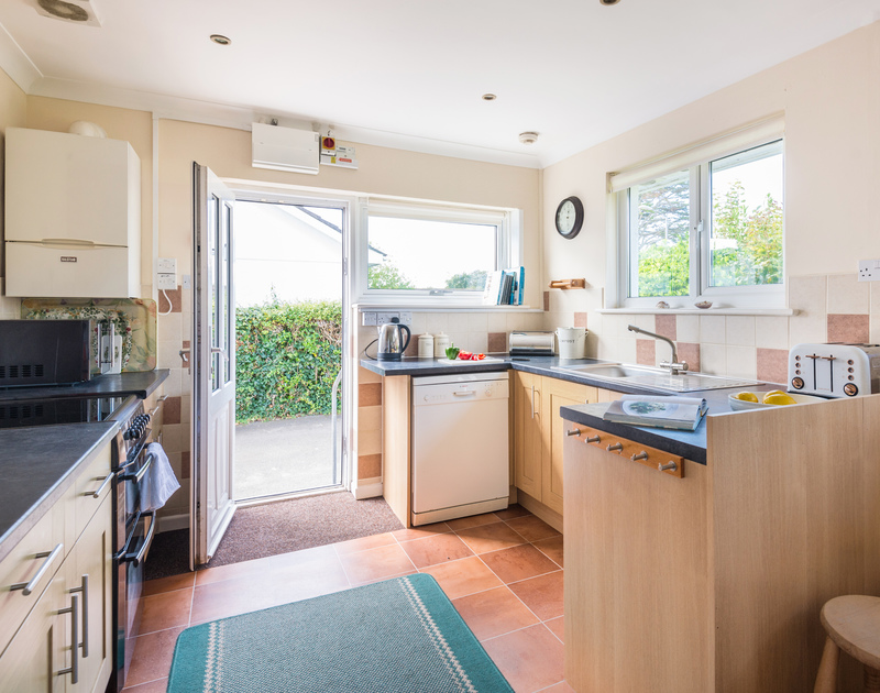 The well equipped kitchen at Chimings self catering pet-friendly holiday home in Rock, North Cornwall.