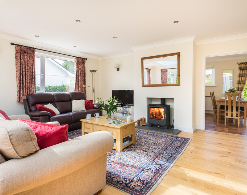 The spacious sitting room with wood burner at Chimings self catering pet-friendly holiday home in Rock, North Cornwall.