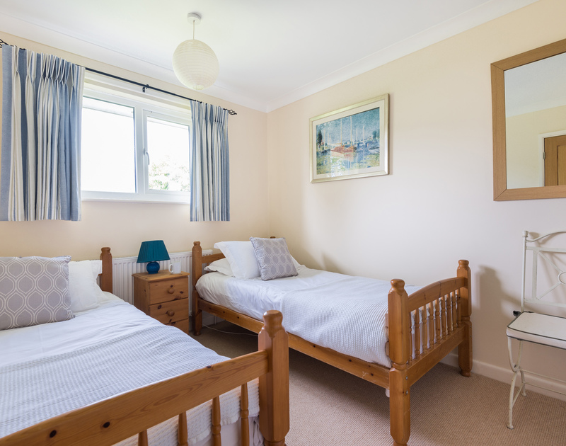 The second twin bedroom at Chimings self catering pet-friendly holiday home in Rock, North Cornwall.