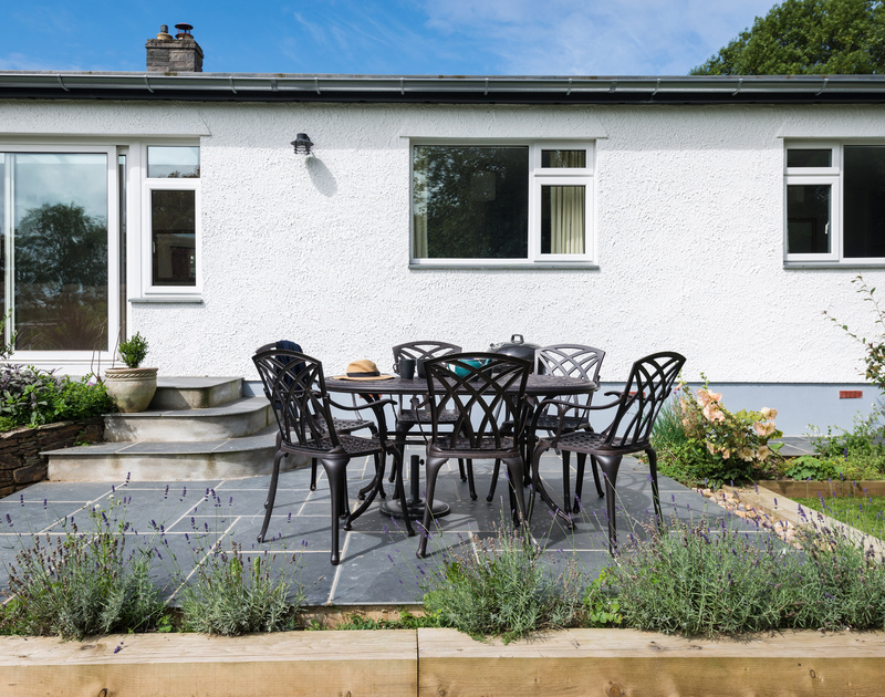 The sunny patio and outdoor seating area at Chimings self catering pet-friendly holiday home in Rock, North Cornwall.