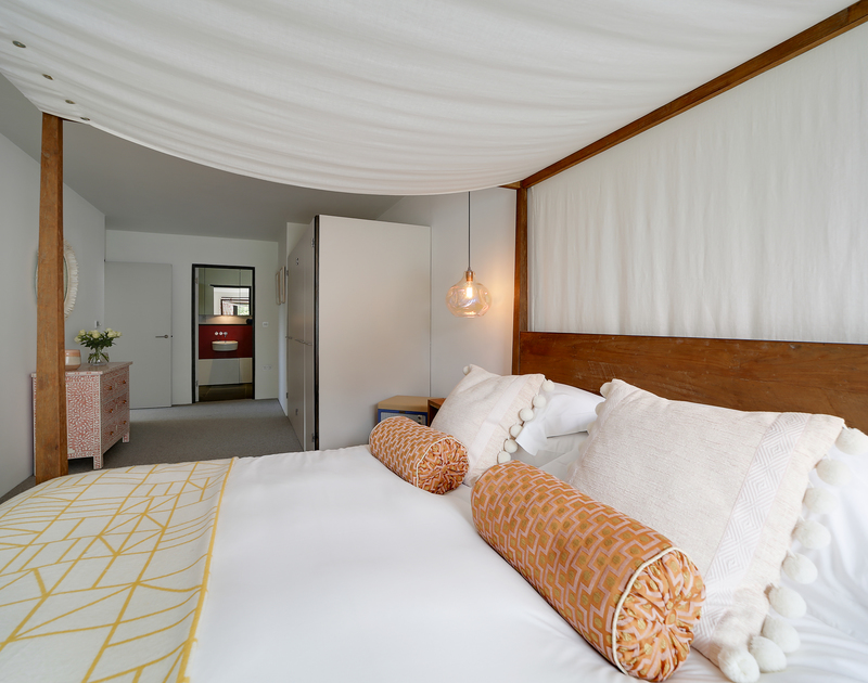 The super king bedroom with pool and garden access and ensuite bathroom at Tresithney self catering holiday home in Rock, North Cornwall.