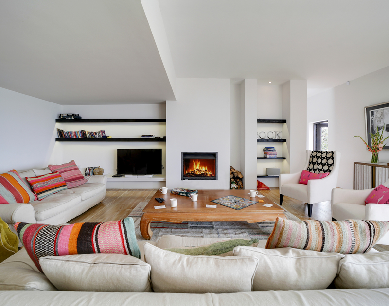 The second lounge with open fire at Tresithney self catering holiday home in Rock, North Cornwall.