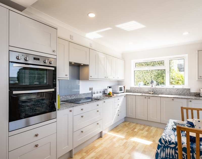 The light filled kitchen at Bay View Cottage self catering holiday home in Daymer Bay, North Cornwall.