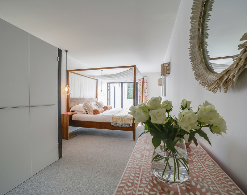 The super king bedroom with pool and garden access and ensuite bathroom at Tresithney in Rock North Cornwall.