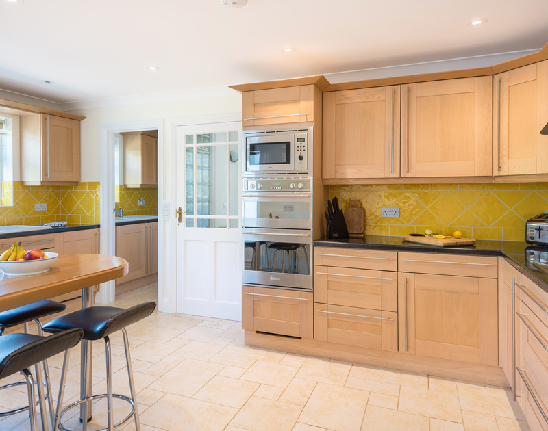 The well equipped kitchen at The Chalet self catering holiday home in Polzeath, North Cornwall.