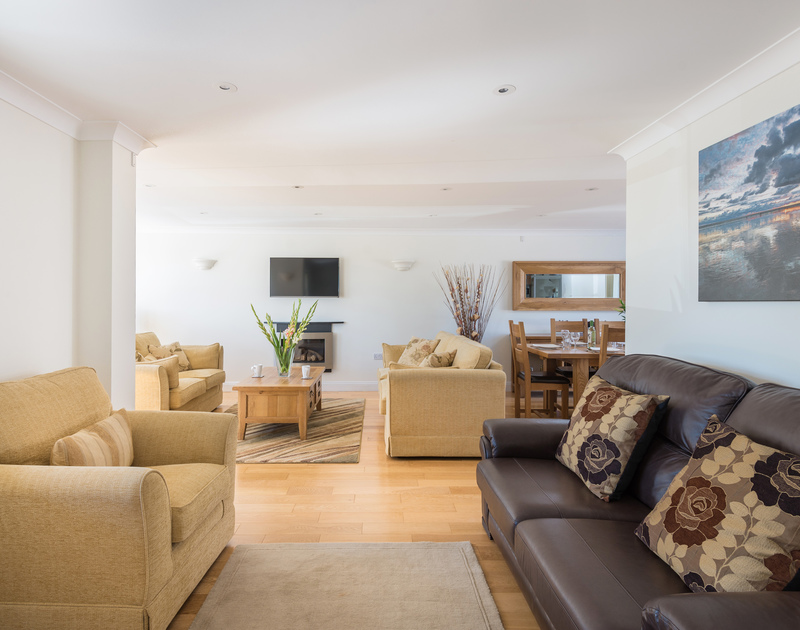 The spacious living room at The Chalet self catering holiday home in Polzeath, North Cornwall.