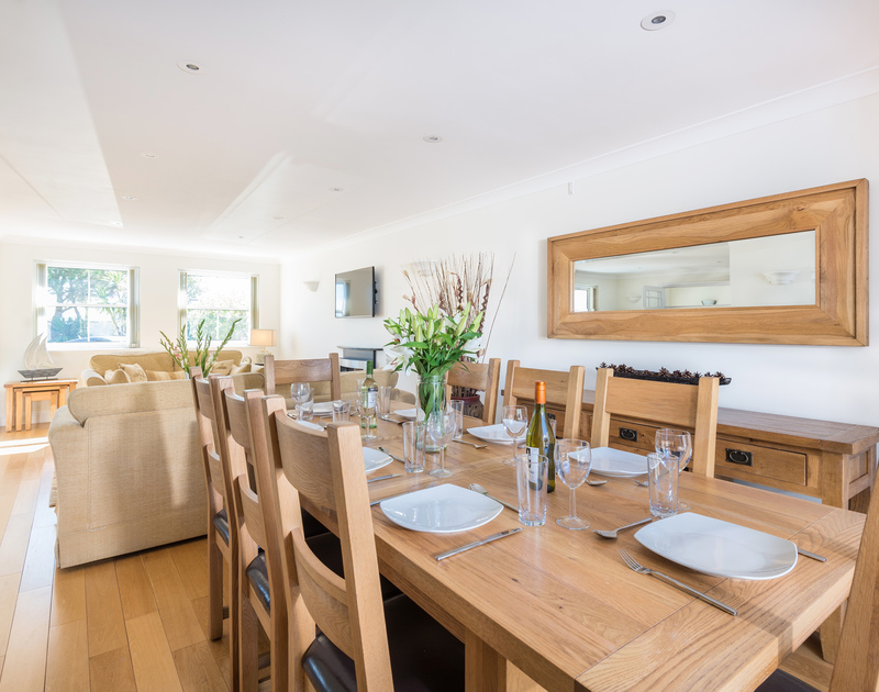 The open plan living room and dining area at The Chalet self catering holiday home in Polzeath, North Cornwall.