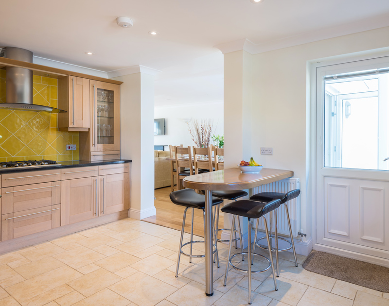 The kitchen with breakfast bar at The Chalet self catering holiday home in Polzeath, North Cornwall.