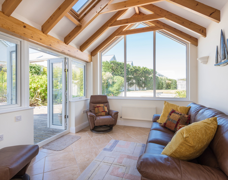 The second living room with doors to the back garden at The Chalet self catering holiday home in Polzeath, North Cornwall.