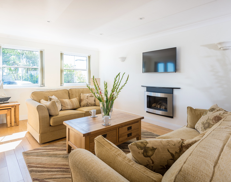 The light filled living room at The Chalet self catering holiday home in Polzeath, North Cornwall.