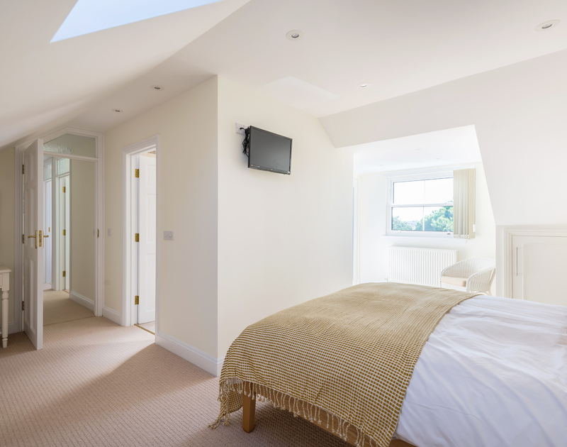 The master bedroom with an ensuite and balcony at The Chalet self catering holiday home in Polzeath, North Cornwall.