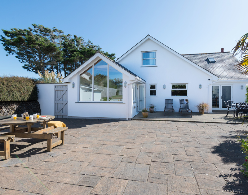 The back garden with seating areas at The Chalet self catering holiday home in Polzeath, North Cornwall.