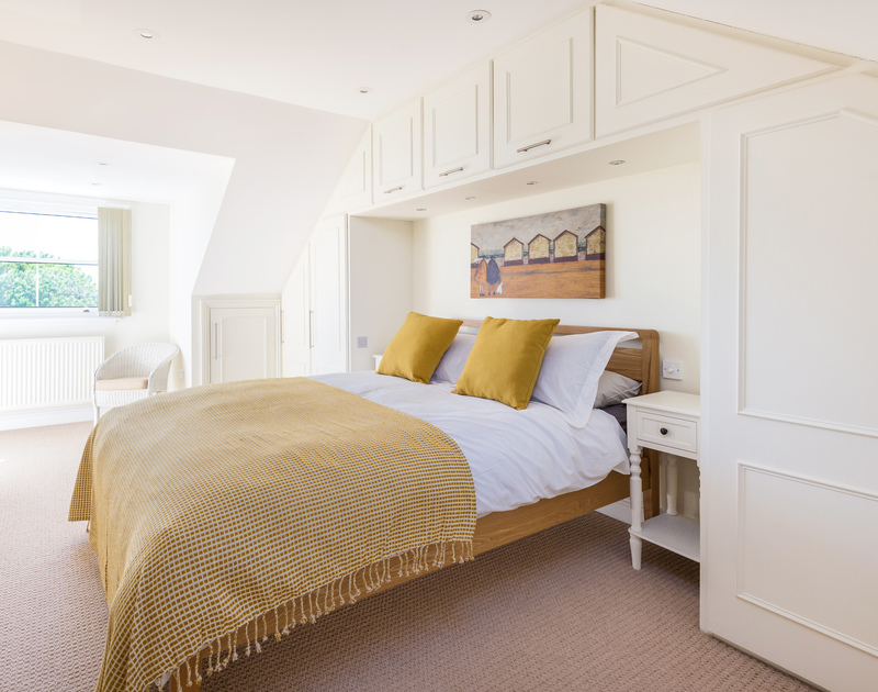 The master bedroom with ensuite and access to a balcony at The Chalet self catering holiday home in Polzeath, North Cornwall.