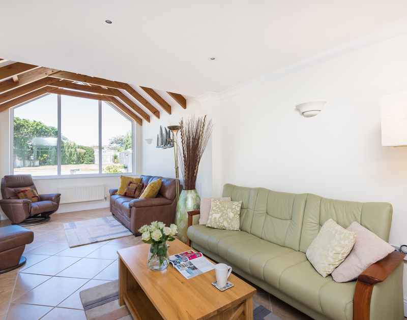The second living room with access to the back garden at The Chalet self catering holiday home in Polzeath, North Cornwall.