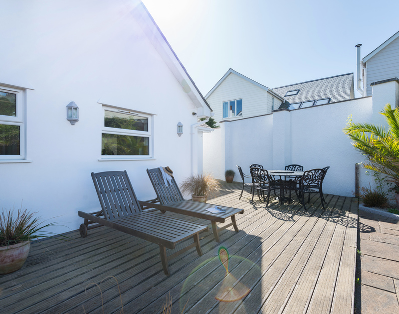 The outdoor seating areas at The Chalet self catering holiday home in Polzeath, North Cornwall.