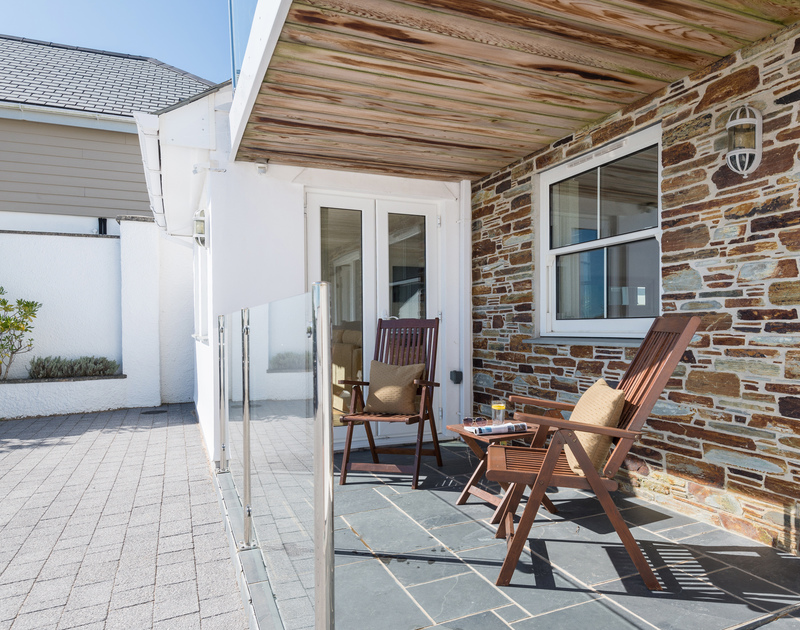 The front outdoor seating area at The Chalet self catering holiday home in Polzeath, North Cornwall.