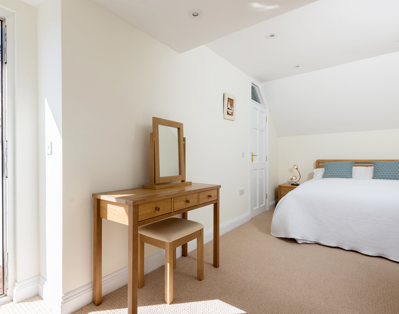 The double bedroom with balcony access at The Chalet self catering holiday home in Polzeath, North Cornwall.