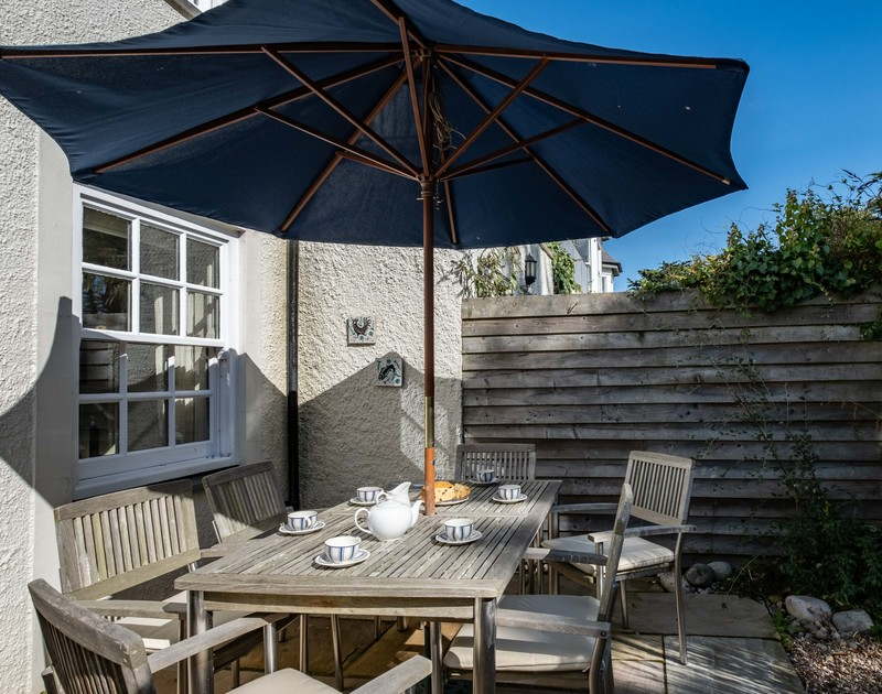 The outside seating area at Lowenna Manor 3 self catering holiday home in Rock, North Cornwall.