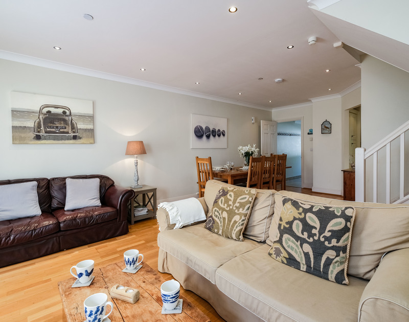 The open plan living room and dining area at Lowenna Manor 3 self catering holiday home in Rock, North Cornwall.