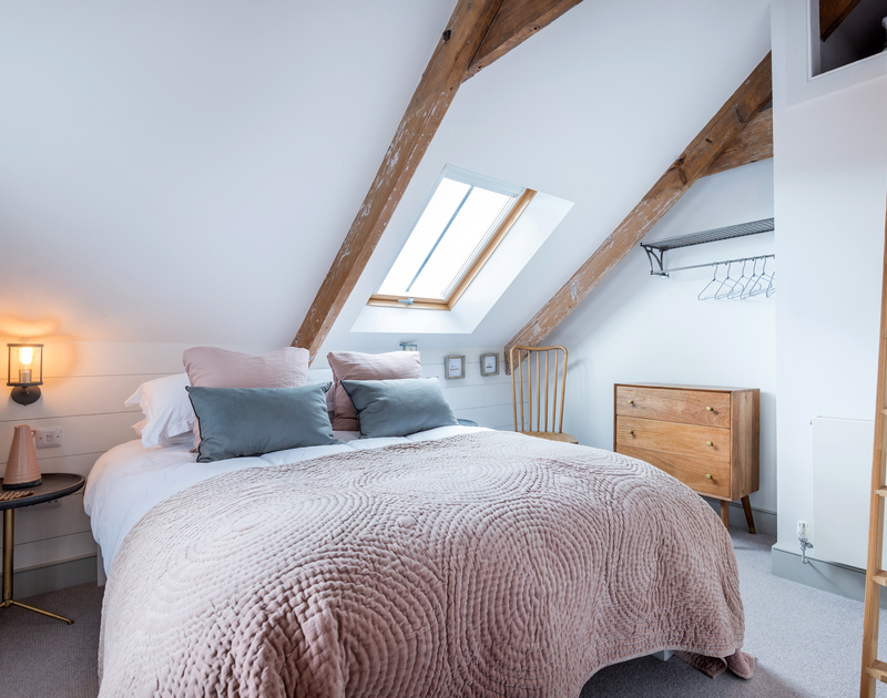 The second bedroom with gorgeous dusky pinks and greys at Albany pet friendly self catering holiday home in Port Isaac, North Cornwall.