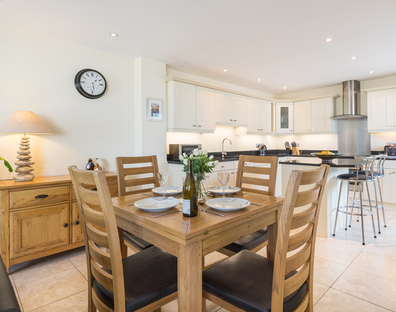 The open plan dining area and kitchen at Sea Gem self catering holiday home in Port Isaac, North Cornwall.