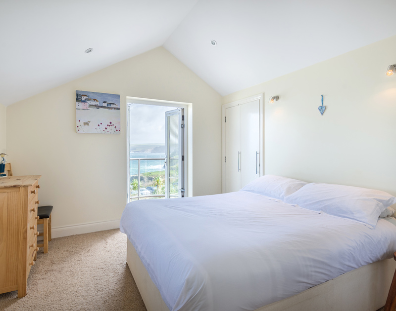 The double bedroom with balcony and sea views at Sea Gem self catering holiday home in Port Isaac, North Cornwall.
