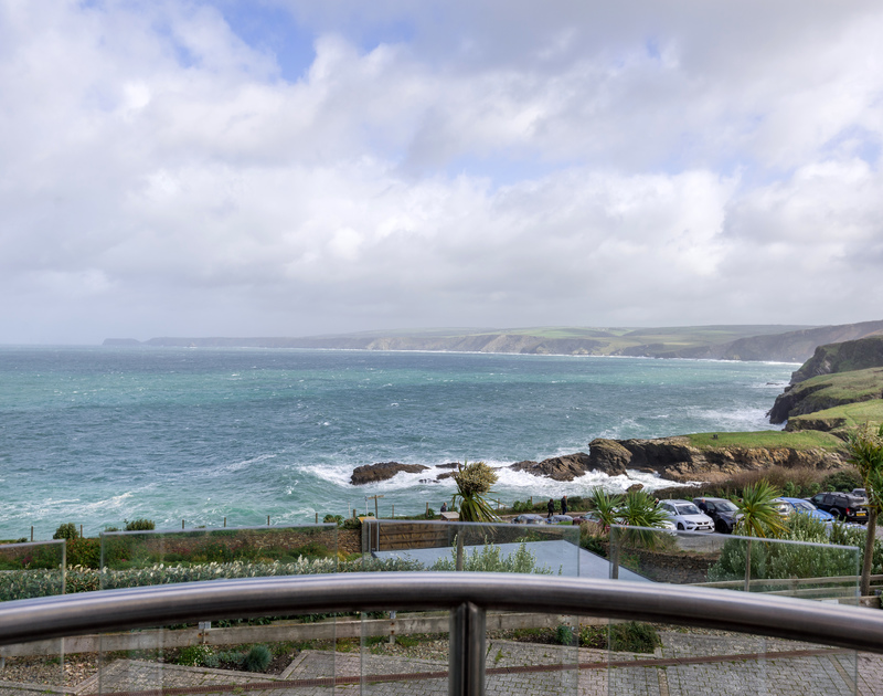 The beautiful sea view across to Tintagel in the distance, from the double bedroom balcony at Sea Gem self catering holiday home in Port Isaac, North Cornwall.