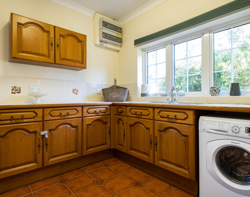 The utility room at Carrek House self catering holiday home in Rock, North Cornwall.